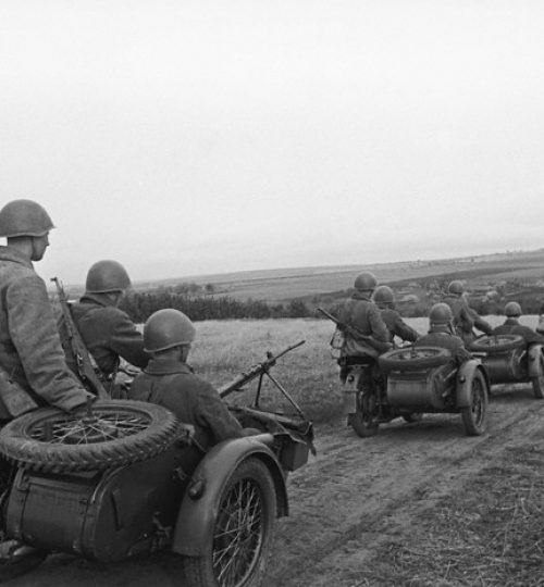 ca. 1943-1945, USSR --- Soviet troops on motorcycles under command of Battalion Commissar E. Khaimov. --- Image by © The Dmitri Baltermants Collection/CORBIS